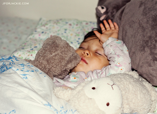 Sleeping Julienne with her stuffed animals
